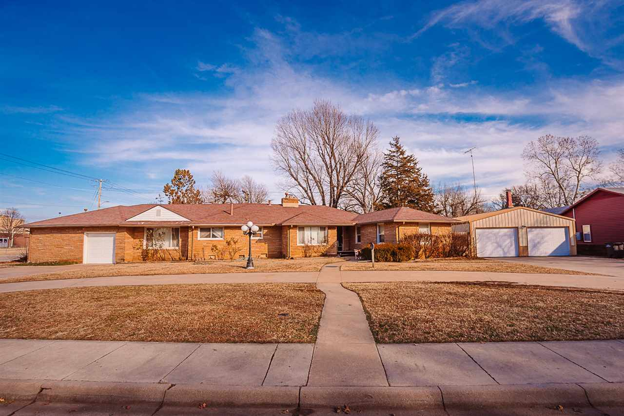 Are you needing a large amount of square footage on a moderate budget? How about a nicely built large detached metal shop/garage? If so, this is the home for you. This spacious all stone ranch home boasts 2,545 square feet, 3 bedroom, 3 bath, 2 fireplaces. Sits on a double fenced yard near parks and schools.