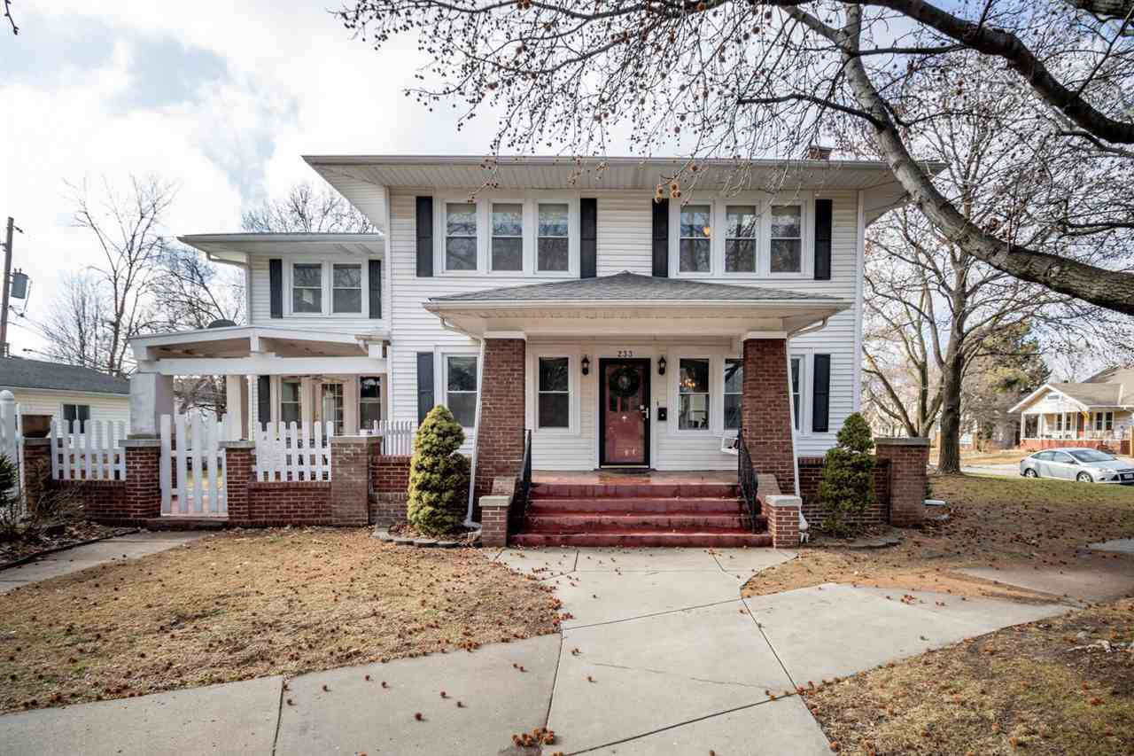 Beautiful two-story home on a corner lot of a tree-lined street with all the charm expected of a hom