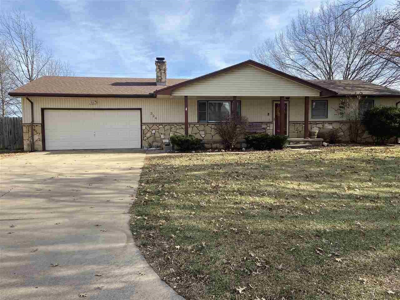 Lovely Home in Rosehill Ks. Over 2,600 square feet finished in this Ranch home. Located on a quiet street. 3 bedrooms, 2 baths on main floor and 3 additional rooms finished in the basement along with a full bath and safe room. 2-Car oversized garage. Easy maintenance Vinyl/Metal siding .2 wood burning fireplaces, one on the main floor living room and one in the family room in the basement. Laundry also located in the basement with washer/dryer included. Kitchen comes complete with all appliances including range/oven, dishwasher, refrigerator and microwave. You'll love watching the sun come up on your covered back deck, also Fenced back yard and storage shed. Updates through out including new flooring in all 3 bedrooms. All appliances stay with property including washer/dryer. Come take a look, you won't be disappointed. Will sell quick, don't miss out!!