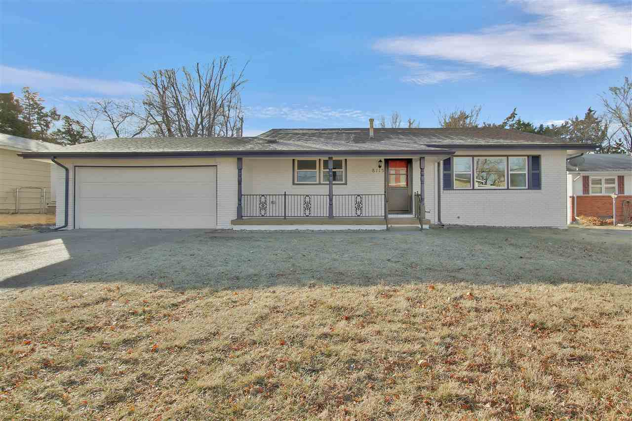 Welcome Home to this remodeled home in Southeast Wichita! All new carpet and wood laminate flooring.