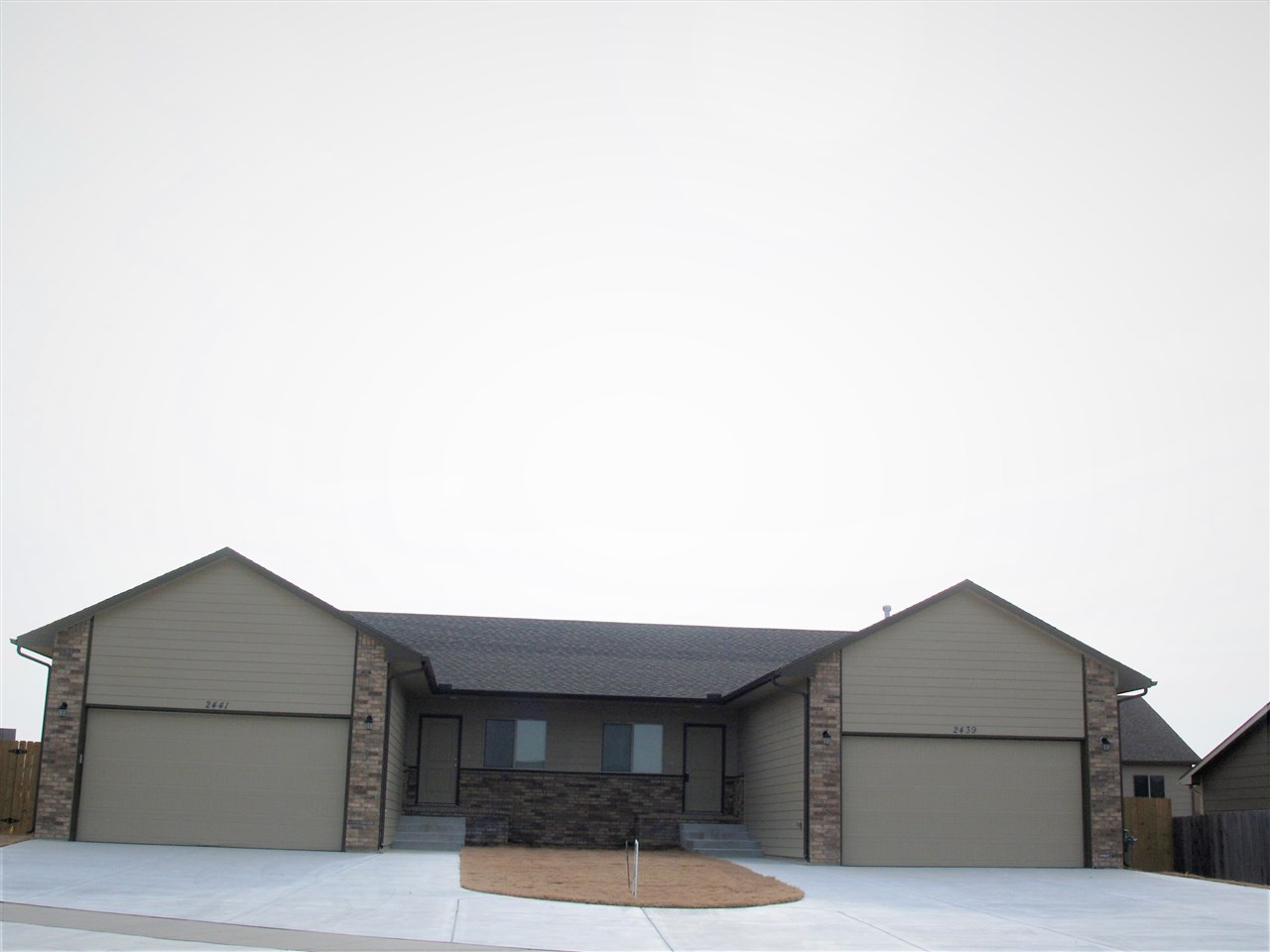 Both sides of this twin home are for sale.  Each side has 2 bedrooms on the main level and two bedro