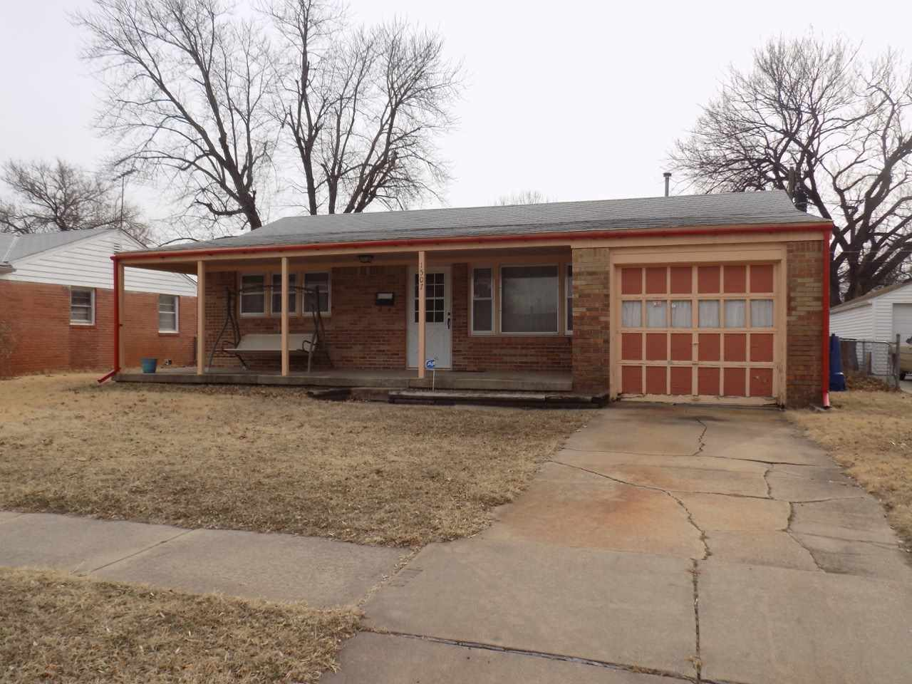 Great opportunity for home ownership or investment property! This 2 BR 1 BA home offers an all brick