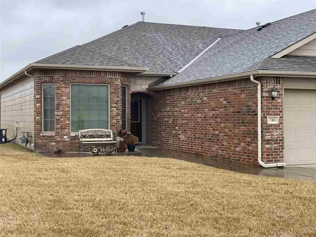 Curb appeal!  Super nice zero entry home offers grounds maintenance for your ease!  The open floor p