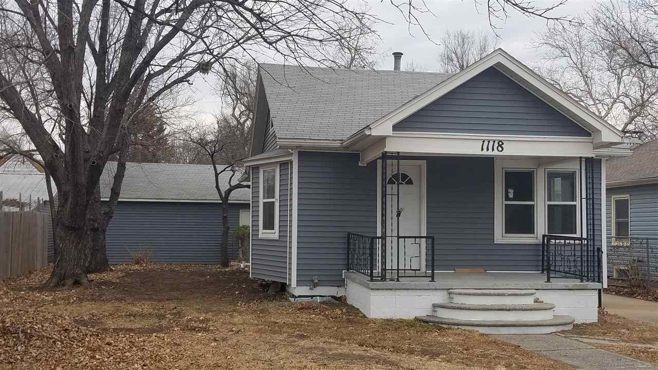 Super Sweet North Riverside Bungalow! This recently updated 2 bedroom 1 bath home has New Siding wra