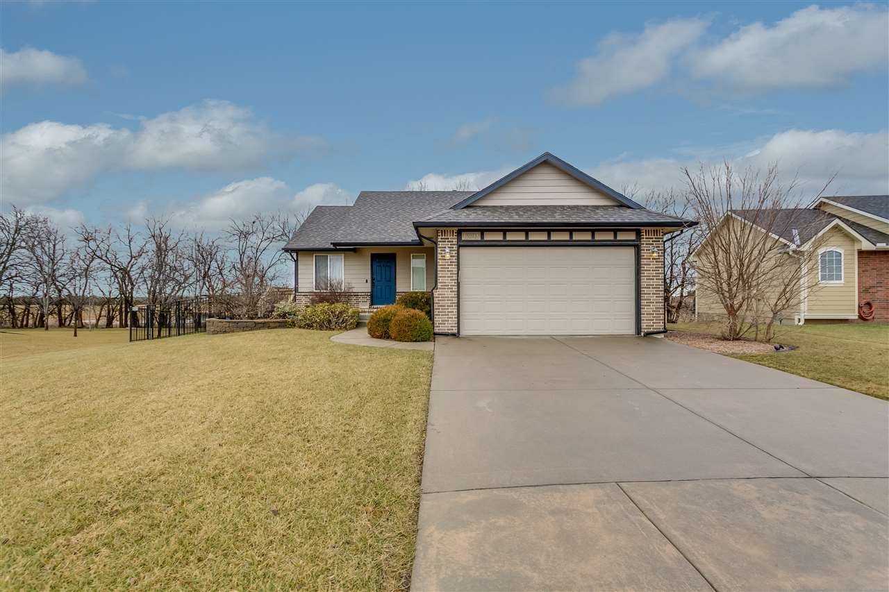Updated and move-in ready in NE Wichita! This open living floor plan boasts vaulted ceilings, a spac