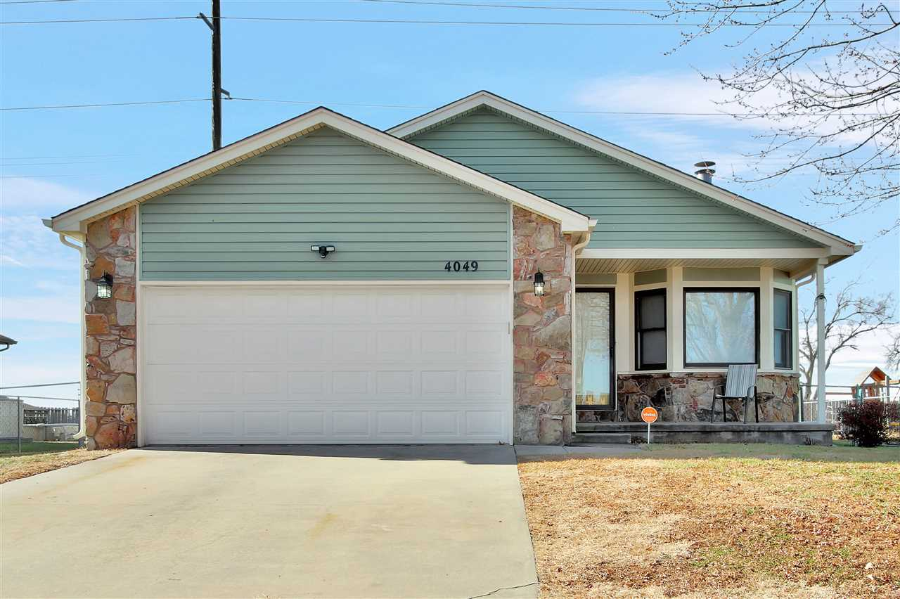 A comfortable and cozy home located in a quiet area of south Wichita. The living room features a woo