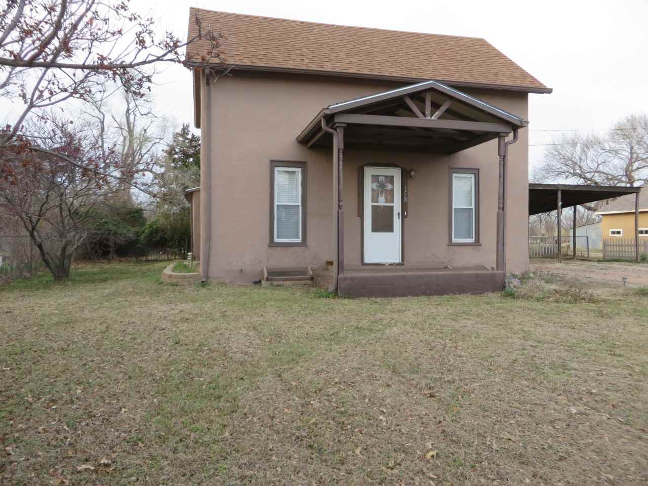 Traditional 3 Bedrooms, 1 Bathroom, large Carport and fenced yard. Home is located in Garden Plain j