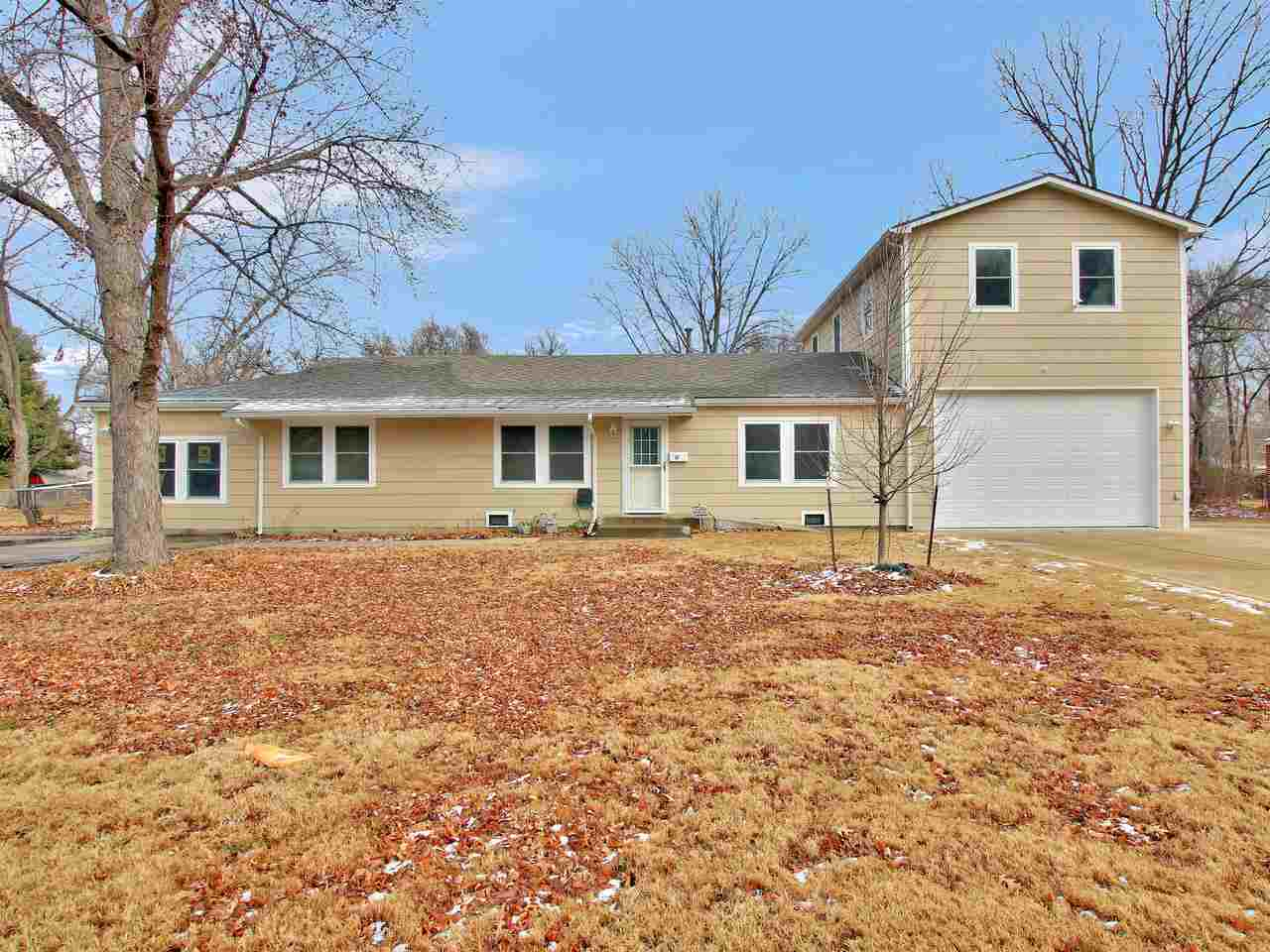 Welcome home to this unique Haysville property, sitting on .46 acres of land. Cozy home with 3 bedrooms, 1 bath. Simple layout. Large, open kitchen-completely remodeled. 10 X 10 storm cellar with interior access. Bonus unfinished room converted from old garage-could be a 2nd family room, play room, bedroom; lots of possibility, just needs creativity and finishing.   Where this property shines is the tandem garage with approximately 800 square feet of potential living space above. The garage is perfect for the perpetual builder/tinkerer. With 200 amps of power. Full bathroom inside. Garage boasts double accessibility for vehicle entry, with a paved drive path from front to back. The unfinished space above has roughed in water and sewer with electricity and a private entry on the back of the garage. Once this space is finished it could be used for a extra family staying, college students, mother-in-law suite, or rentable space. Lots of options!  Backyard is full fenced with a large concrete patio perfect for family gatherings, with opportunity to house an above-ground pool. Also in the backyard is a large shed, with 100 amps of power, could be a she-shed!  Neighborhood is quiet, elementary and middle school is nearby within walking distance.   Within the last 5 years the home has been remodeled with light fixtures, roof, air conditioner, furnace, windows, and siding.   Contact me to see this special home!