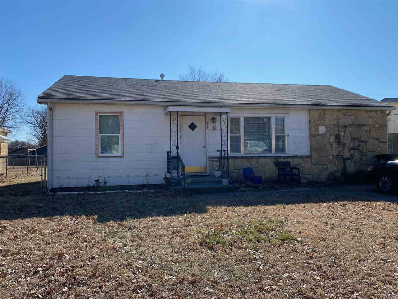 This 2 bedroom (possibly 3rd bedroom) is in an excellent location with a large fenced in backyard! Very clean and nice on the inside!  Close to all of the schools this would make an excellent home for anyone looking on a moderate budget! This would also make a perfect rental property for anyone looking to invest! Call listing agent today to schedule a showing!