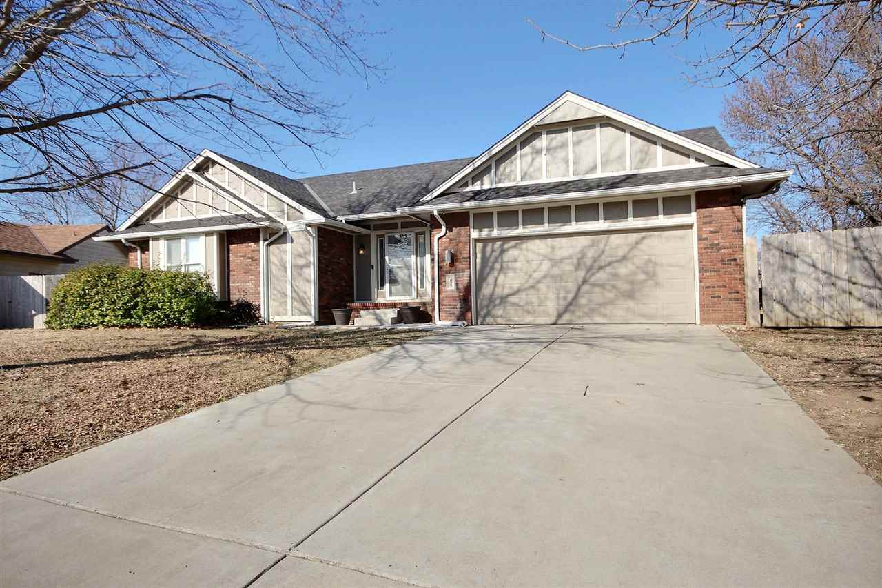 Beautifully updated home in Derby! Open floor plan with wood lament floors and modern concrete count