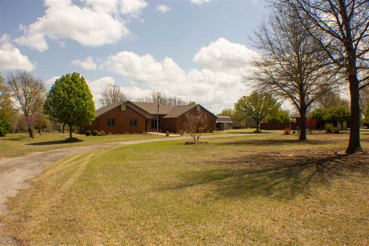 This ALL BRICK zero entry home is Heaven on Earth!  It features 2.8 acres with a heated shop, whole