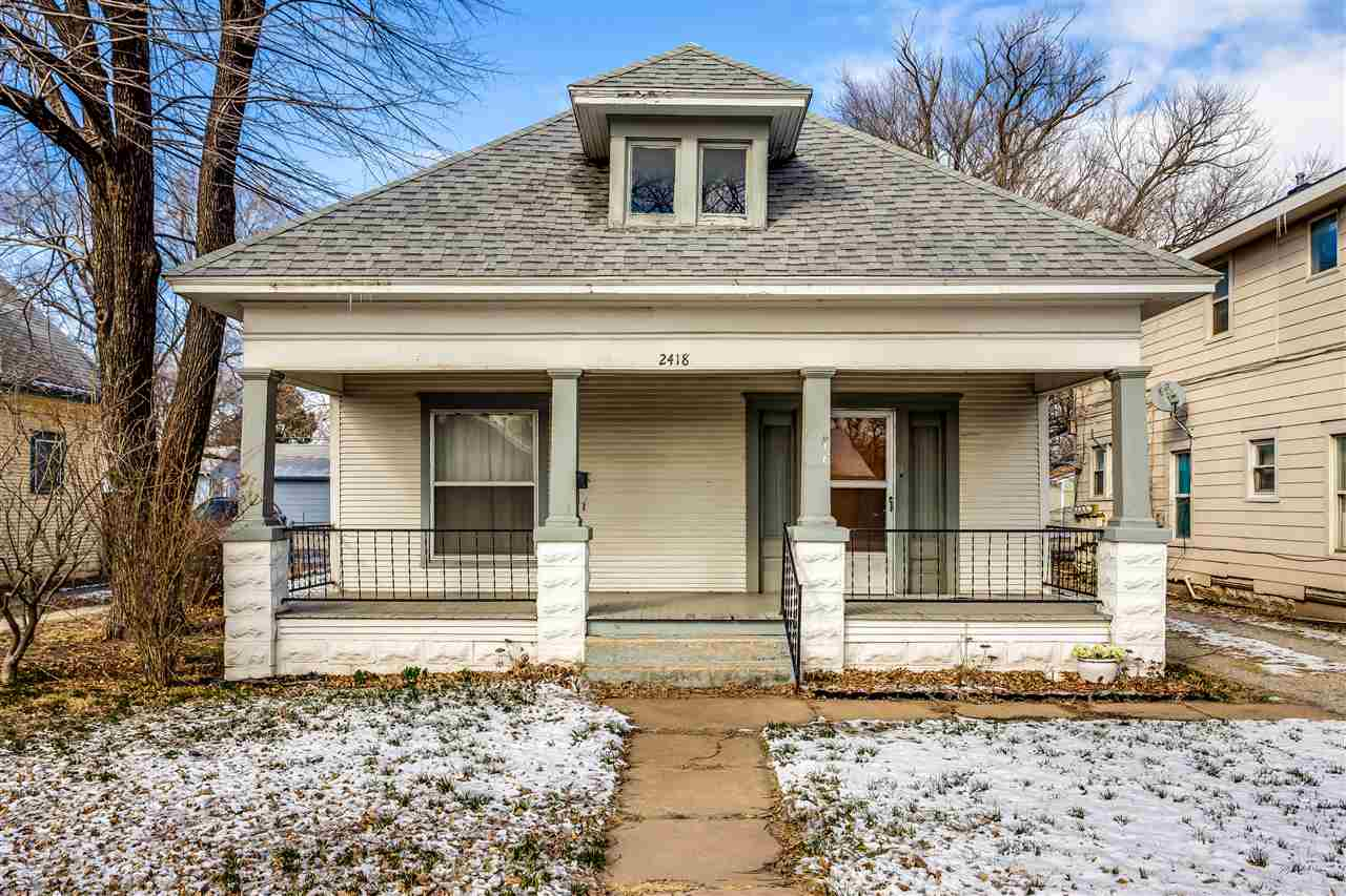 Classic bungalow style with covered front porch spanning the front, a short walk across the street a