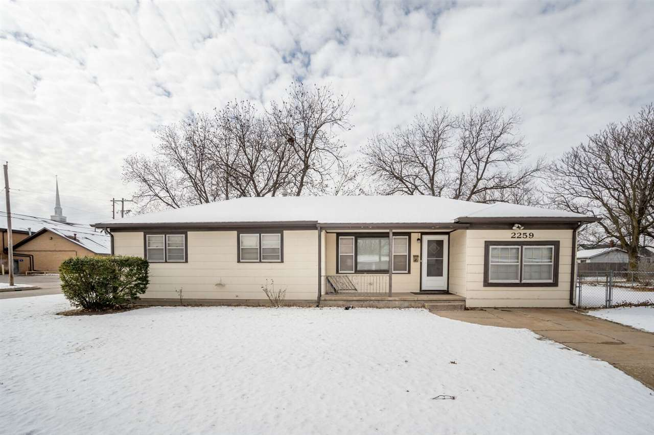 3 bed 1 bath home in SW Wichita on a huge corner lot! Hard wood floors in the living room and all be
