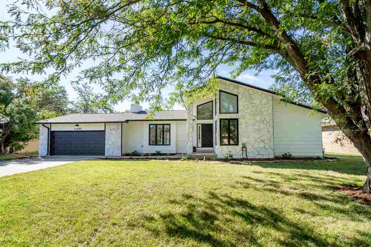 This newly updated home in West Wichita is a must see! Starting with the curb appeal, the stately ar