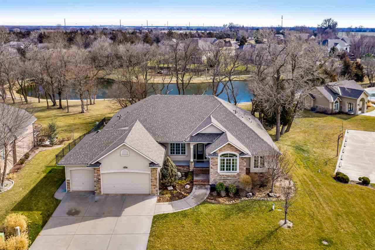 An Impeccable Custom Built Mike George Home. it sets on Beautiful Wooded, Lake Lot. The Open Floor P