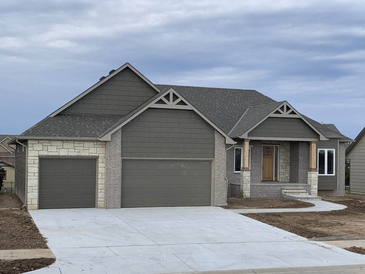 Great new home with a 4 car garage, 19 x 7 front porch, 18 x 12 covered deck, open floor plan, 95% g