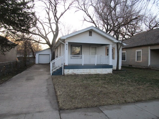 This charming bungalow features 2 bedrooms, 1 bath, a large kitchen with dining space, hardwood floo
