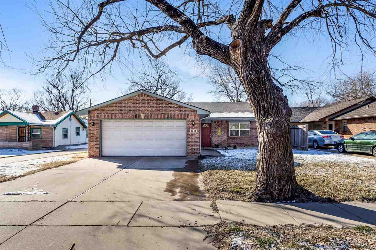 Turn key brick ranch is close to downtown, fully privacy fenced yard, new flooring in the living and