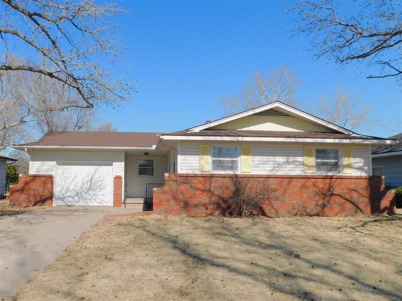 Well-kept 2 bedroom, 1 1/2 bath home with a 1 car attached garage, that has a double garage door lea