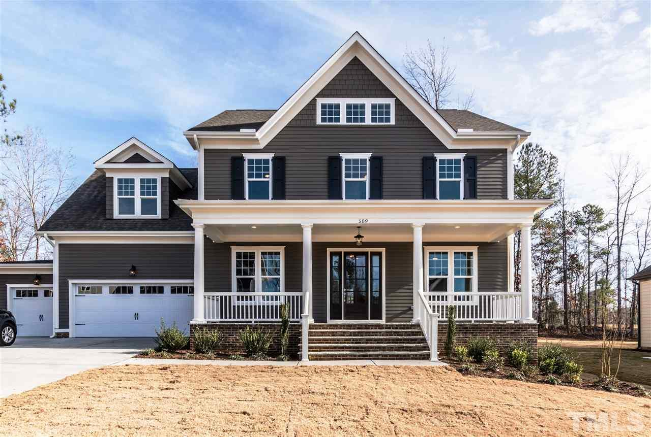Photo of home for sale at 509 Ancient Oaks Drive, Holly Springs NC
