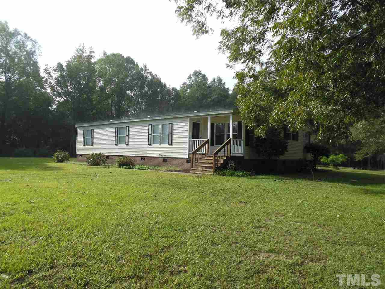 Remodeled triple wide on foundation. New Interior. Home sits toward the back of the property. Private well and septic with plenty of road frontage on Ten Ten. Amenities less than 2 mi. New paint, HVAC, kitchen, carpet, and roof. Sits next to Vance Elementary and the walking track is an easy access. 13 acres of unrestricted land - additional $500 per month.