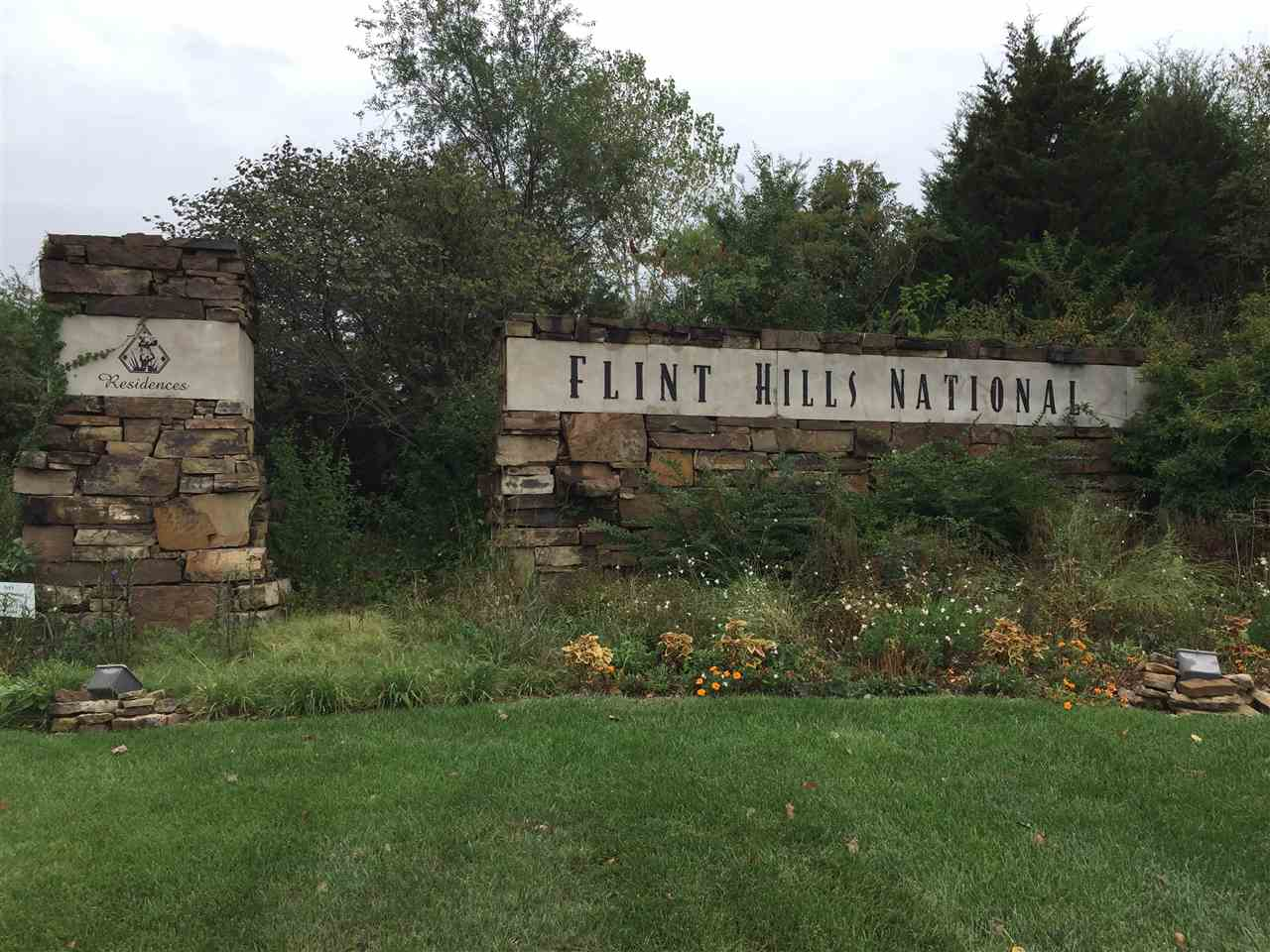 1.6 acre wooded home site in the prestigious Flint Hills National nationally ranked golf course community.  Spacious lot backing to commons area, plus wooded commons area across street.  Minimum main level square footage is 2,500 SF.  Great lot with great views and low specials!