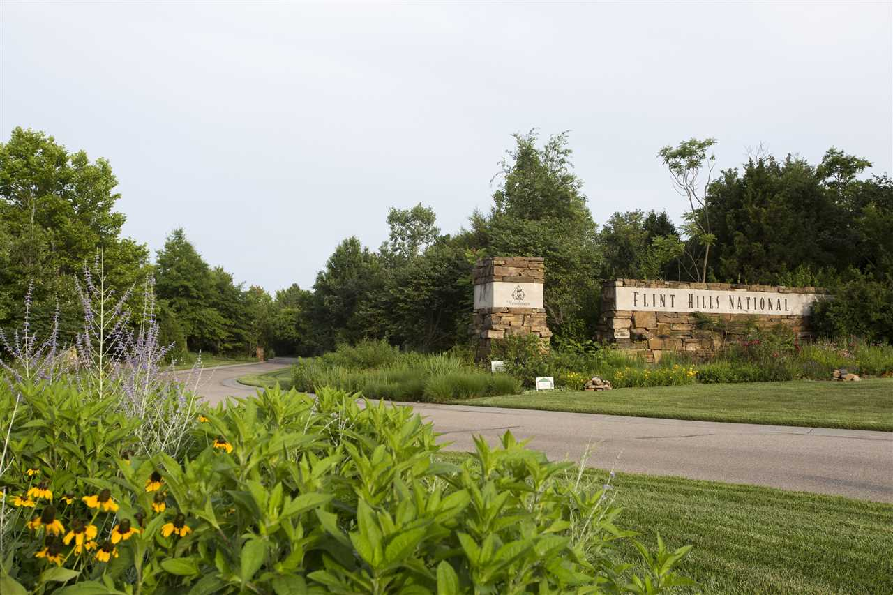 4.5 acre home site in the prestigious Flint Hills National nationally ranked golf course community.  East facing backyard with beautiful estates on each side. Minimum main floor square footage is 3,000 SF.  Beautiful, quiet, gated community!