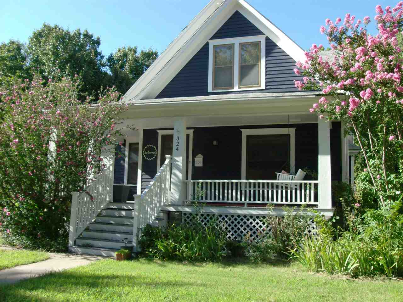 Charming home in Newton's Historical District! Enjoy having coffee on the front porch swing as you prepare for the day. Enter into large living room with wood floors, original woodwork through-out and radiator heat. Dining room is large enough for family gatherings and a sun porch for extra fun. Foundation repairs were completed in 2012 with a 25 year guarantee.  Call agent with questions.