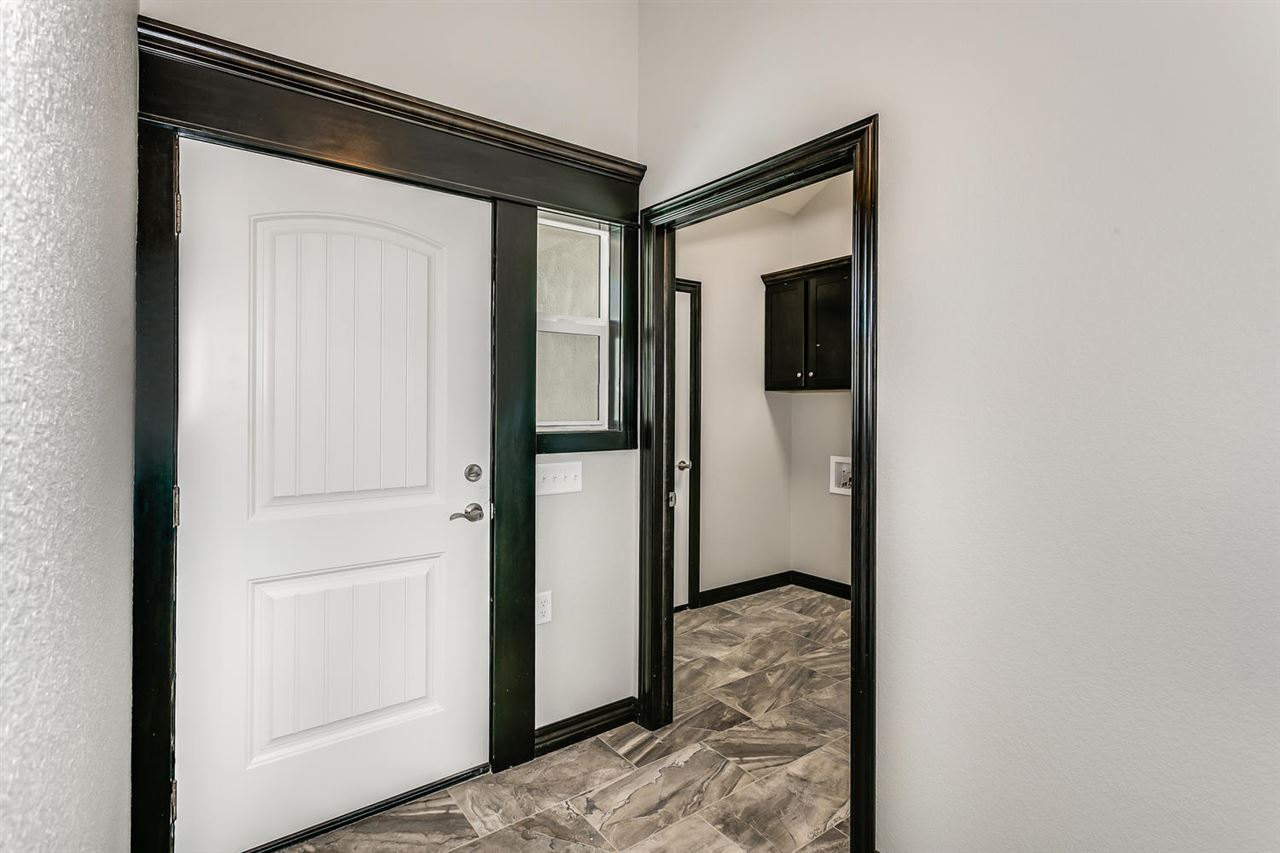 Come see what all of the excitement is about! Derby's newest maintenance free community just got better! This slab on grade condo features two large bedrooms, two full sized bathrooms, heated flooring throughout, an open and bright kitchen, and plenty of space to make it your own! Private master suite boasts a huge walk in closet, and secluded retreat area for relaxing or reading, and a gorgeous bathroom with a walk in tile shower and double vanity! Hidden safe room/tornado shelter behind master retreat will give you peace of mind during tornado season. You won't want to miss this one! *Model home located in unit 501