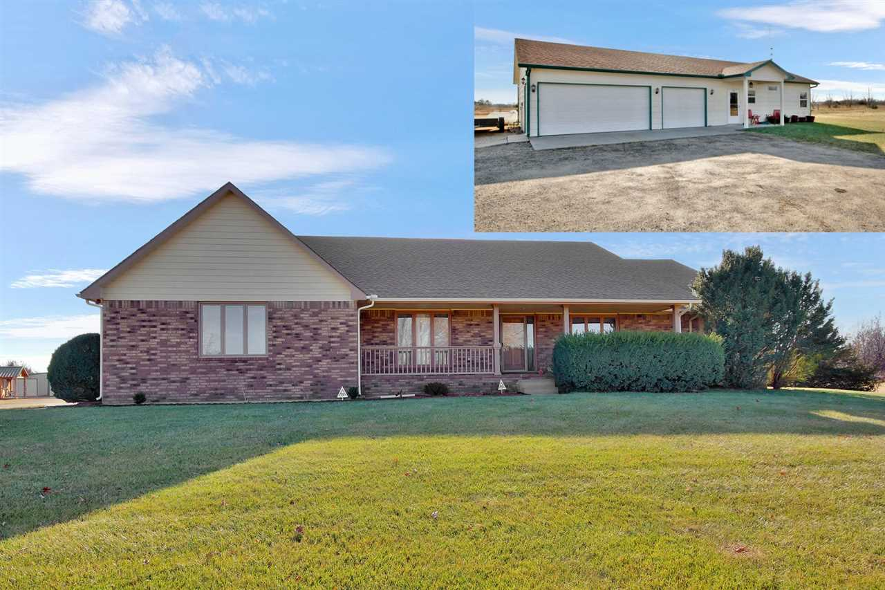 This great custom built home is located on 5 acres in the Goddard school district. If you are lookin