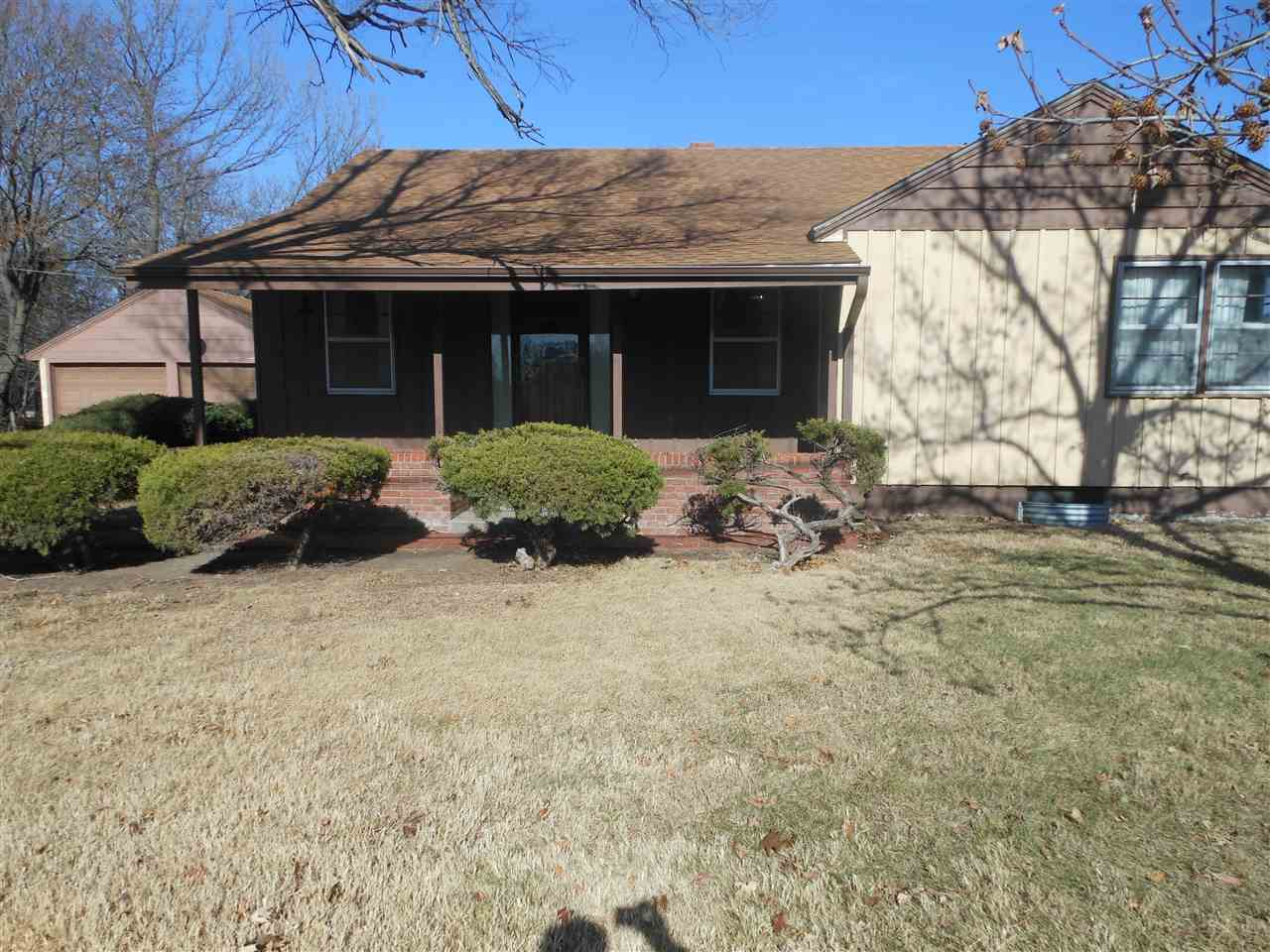 This home was previously used as a single family home with a guest quarters. But is designed and can be locked to allow for two self contained homes. There is a door between the living areas on the main floor that can be locked. Great location, seller thinks that there may be wood floors under some of the main floor carpet, buyer must confirm for sure.  New roof and guttering installed 2018, new refrigerator on west side replaced 2019. Carpet cleaned on west side unit. East side has not been lived in for many years. Electric fireplace in east living room could be moved over to the west unit. Washer dryer in basement stay with home. Two O.H. door remotes stay with the home. Lots of opportunities with this home! Seller has not lived in the home, so we do not have a Seller Property Disclosure. Partial wood fence in back yard. Seller has repaired the basement walls!!