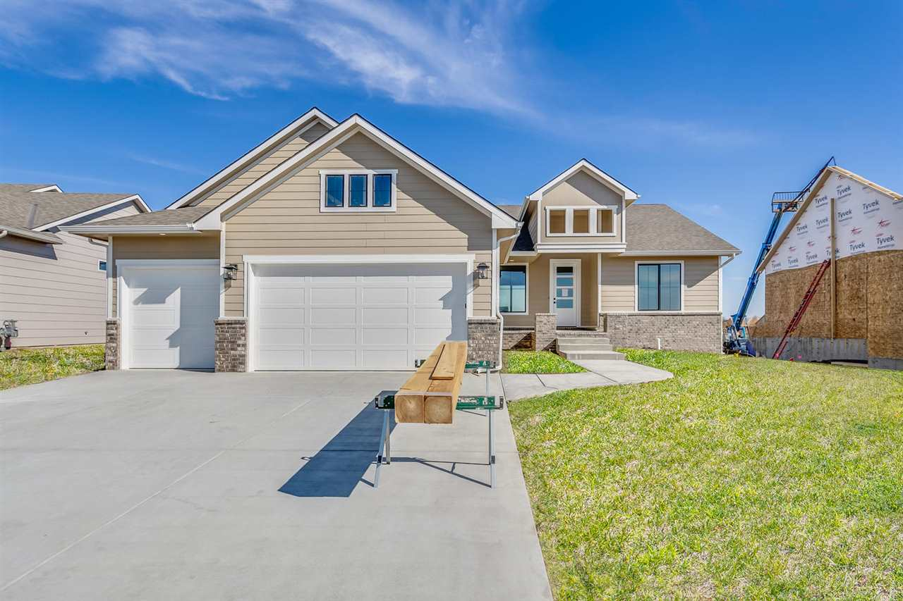 Gorgeous new Paul Gray plan on a great lot with east backyard! The Isabella plan with large windows,
