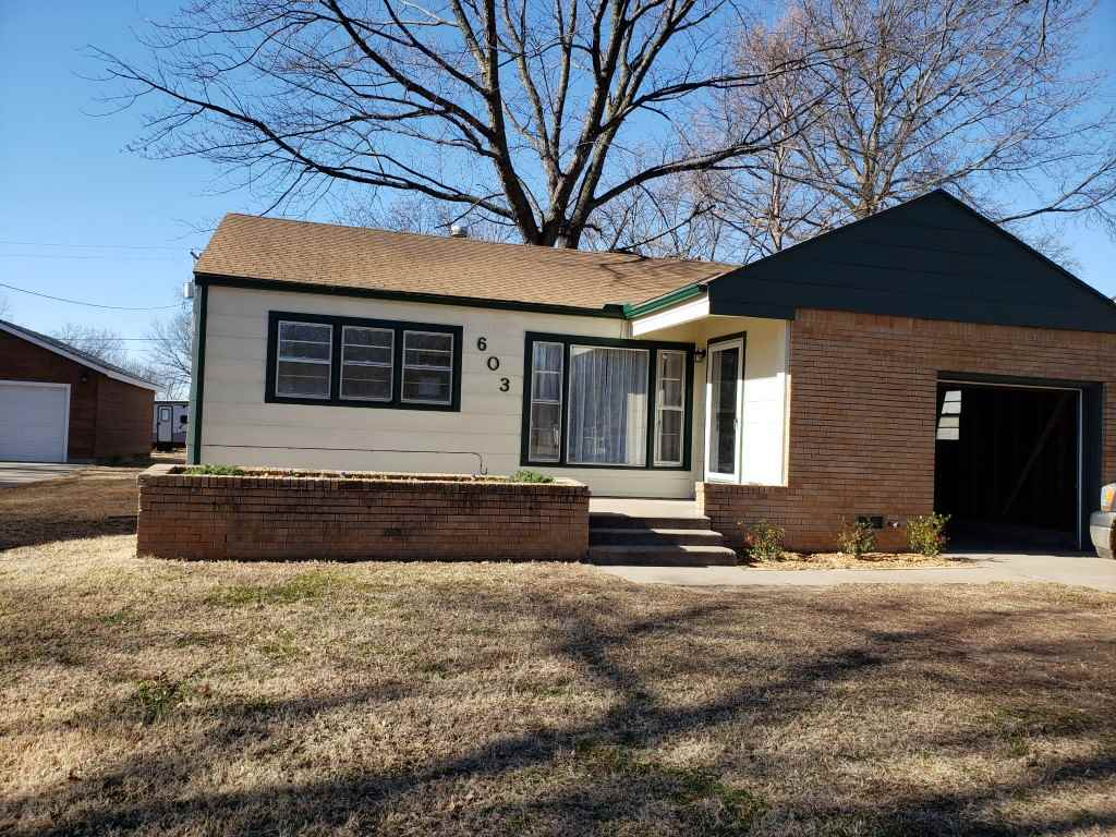 Cute 2 bedroom, 1 bath, 1 car garage with large yard. Waterproof laminate flooring throughout, custom counter-tops in kitchen, updated bathroom, private frontage road off main street. Seller offering $2000.00 roof allowance with full price offer.