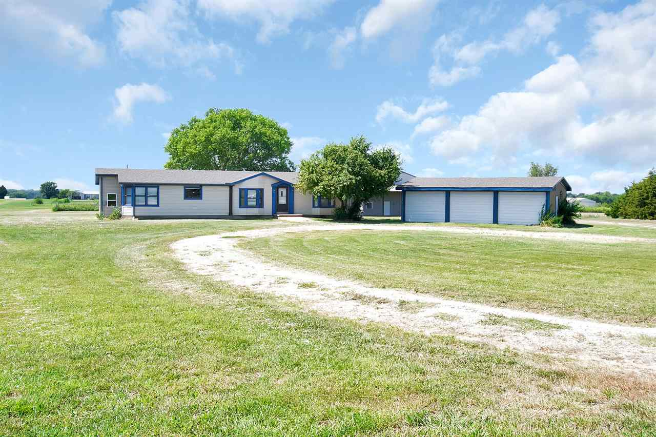 Looking for a rural property with airstrip access and hangar or just wanting a large shop? This is t