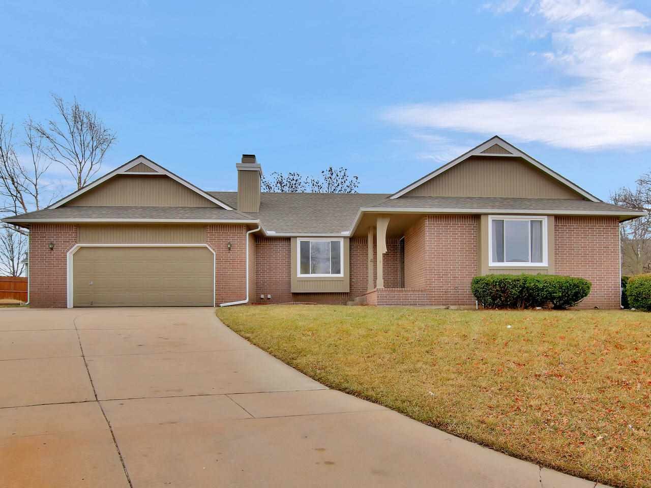 Spacious 4BR, 3.5BA ranch located on a cul-de-sac lot.  Offering many features including vaulted ceilings, 2 WBFP w/gas starter, main flr laundry, 2-car gar w/extra parking on the side, WO LL, large mstr suite has walk-in closet & mstr bath includes separate shower, jetted tub, & vanity with 2 sinks.  Several new updates include some windows replaced, new carpeting & paint.