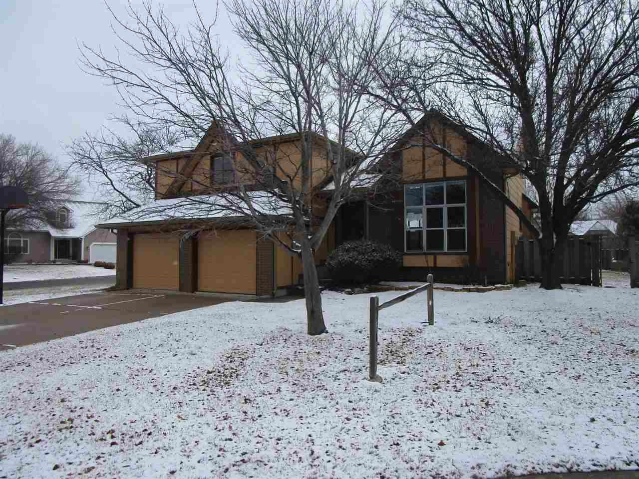 **FHA $100 Down Program Available For Eligible Buyers** Awesome Quad Level Home on a corner lot in a