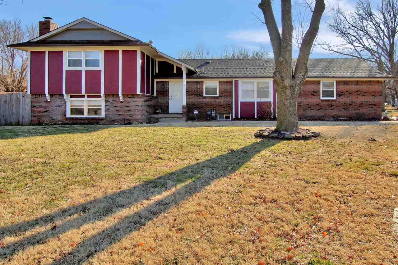 Very roomy quad level home sitting on 1.63 acres in sought-after subdivision in Derby.  3 bedrooms and 2 bathrooms are located on the upper level.   Large living/dining room area, kitchen & breakfast nook on main floor.  Lower level features 2nd living space WB fireplace, laundry, storage, 4th bedroom and 3rd bathroom.  Basement boasts huge rec room and wet bar & more storage.  Lots of updating throughout.  Exterior amenities include oversized patio with fire pit, deck and storage building.  Newer high-grade exterior paint, also.  New storm windows, a/c new in 2016, roof new in 2016.  Large, beautiful lot - this one won't last!