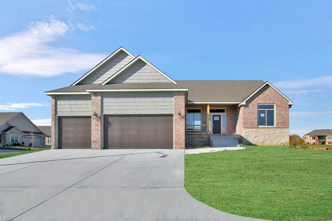 Beautiful new build with custom wood beams, lake view, split bedroom plan.  Lots of extra include mostly all brick and stone front, gas fireplace, view/walkout basement, price includes sod and sprinkler.  Home completed as of 11/1/19.