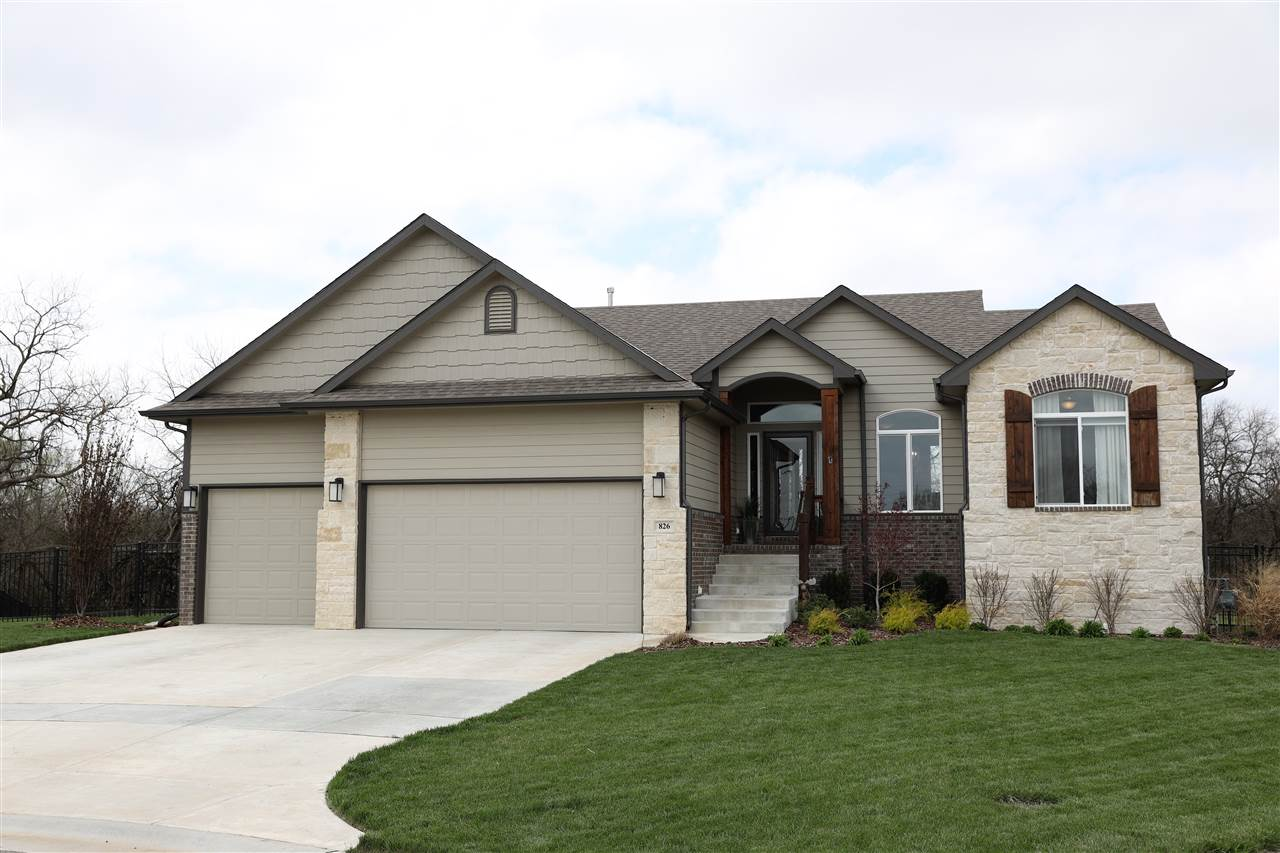 Beautifully designed and well maintained home in Emerald Valley Estates. Open concept main floor wit