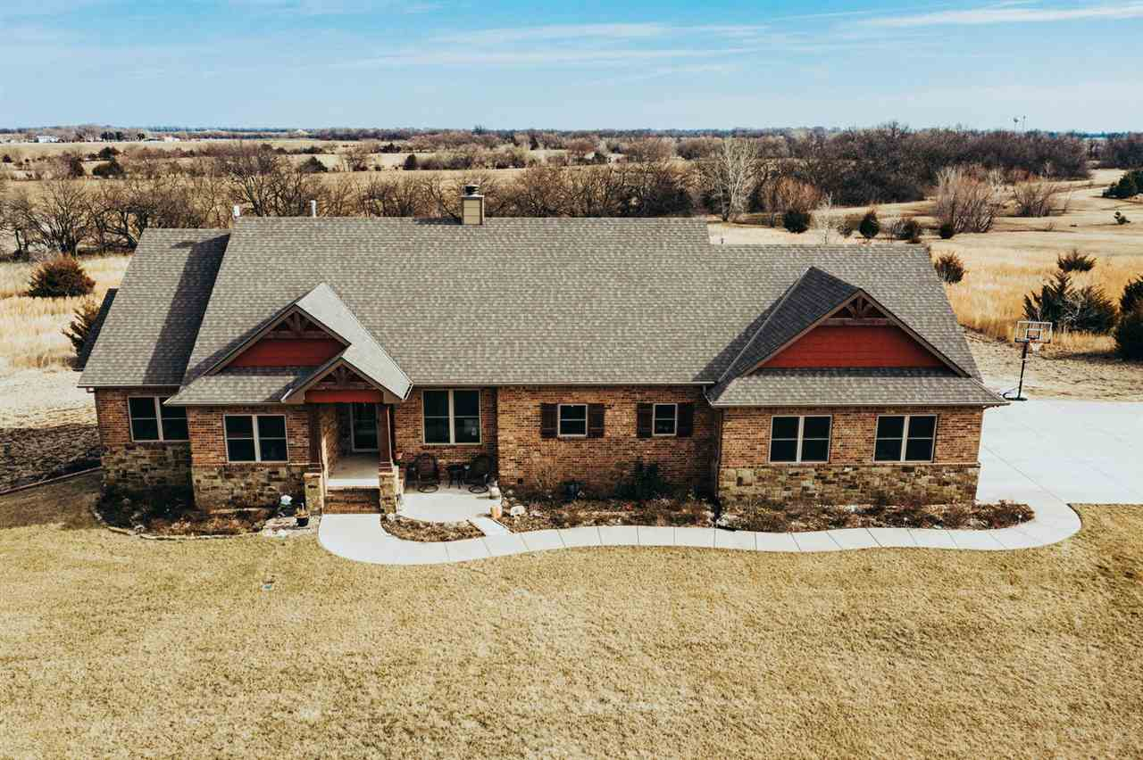Beautiful custom built home (Lies/Bugner) on 4.38 acres. 15 min from west Wichita restaurants and sh