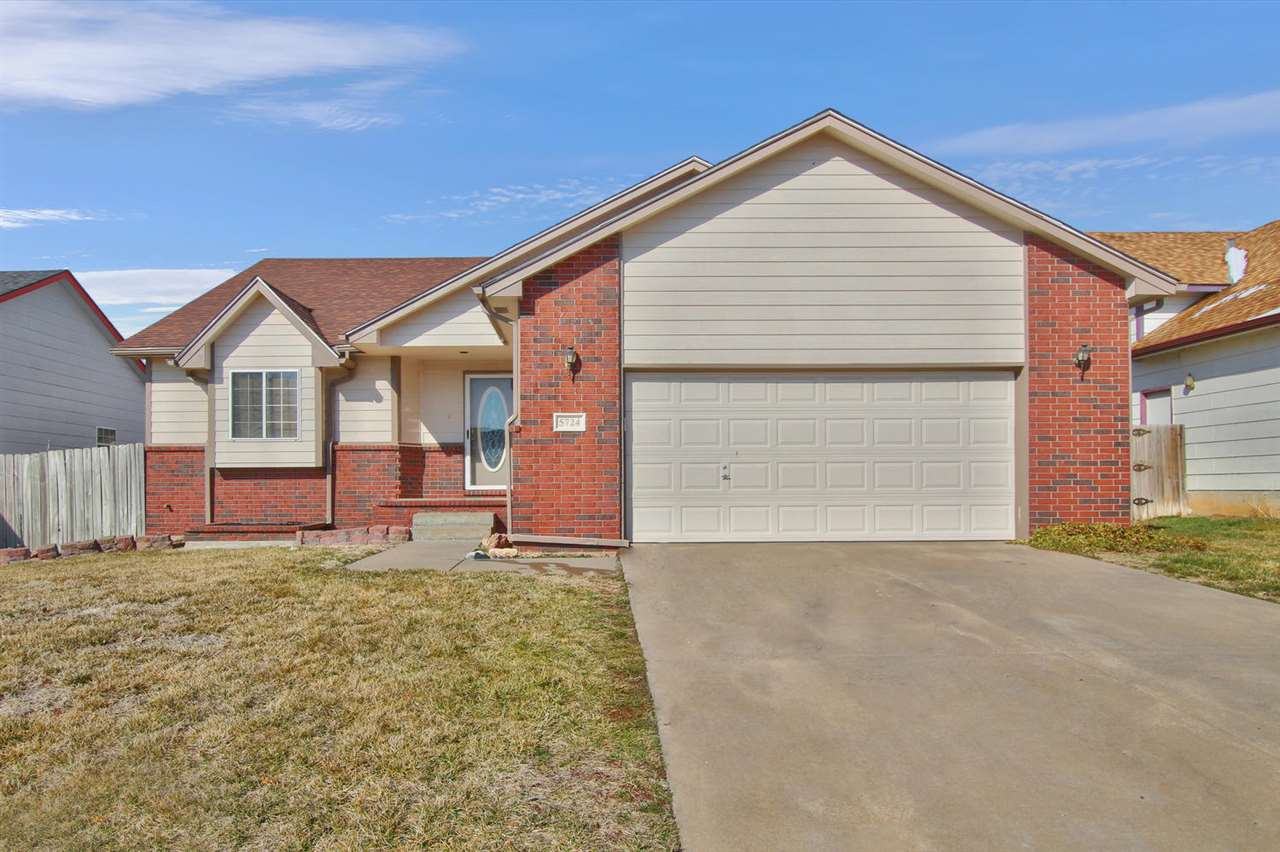 Welcome home to this spacious 4 bed/3 bath/2 car garage home in SW Wichita.  This house is completel