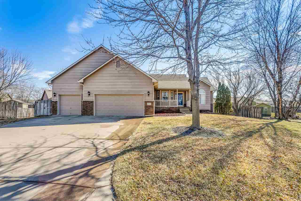 SITUATED AT THE END OF A CUL DE SAC IN THE MAIZE SCHOOL DISTRICT, THIS WELL MAINTAINED RANCH WOULD M