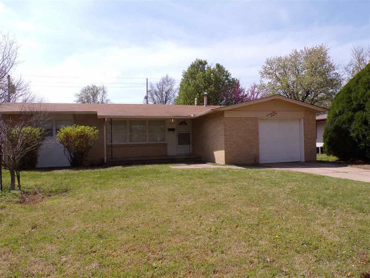 Looking for an affordable West side location?  All brick home features a large living room with plen