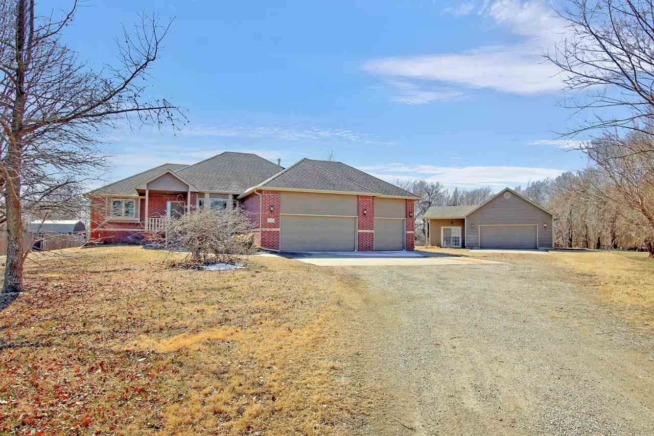 DERBY SCHOOLS!!  Super rare find.  Large 5 bedroom home with 3 full baths on over an acre.  This hom