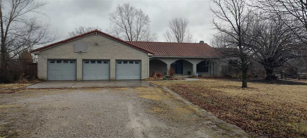 A slice of country heaven. A premium ranch with long winding driveway lined with beautiful Bradford