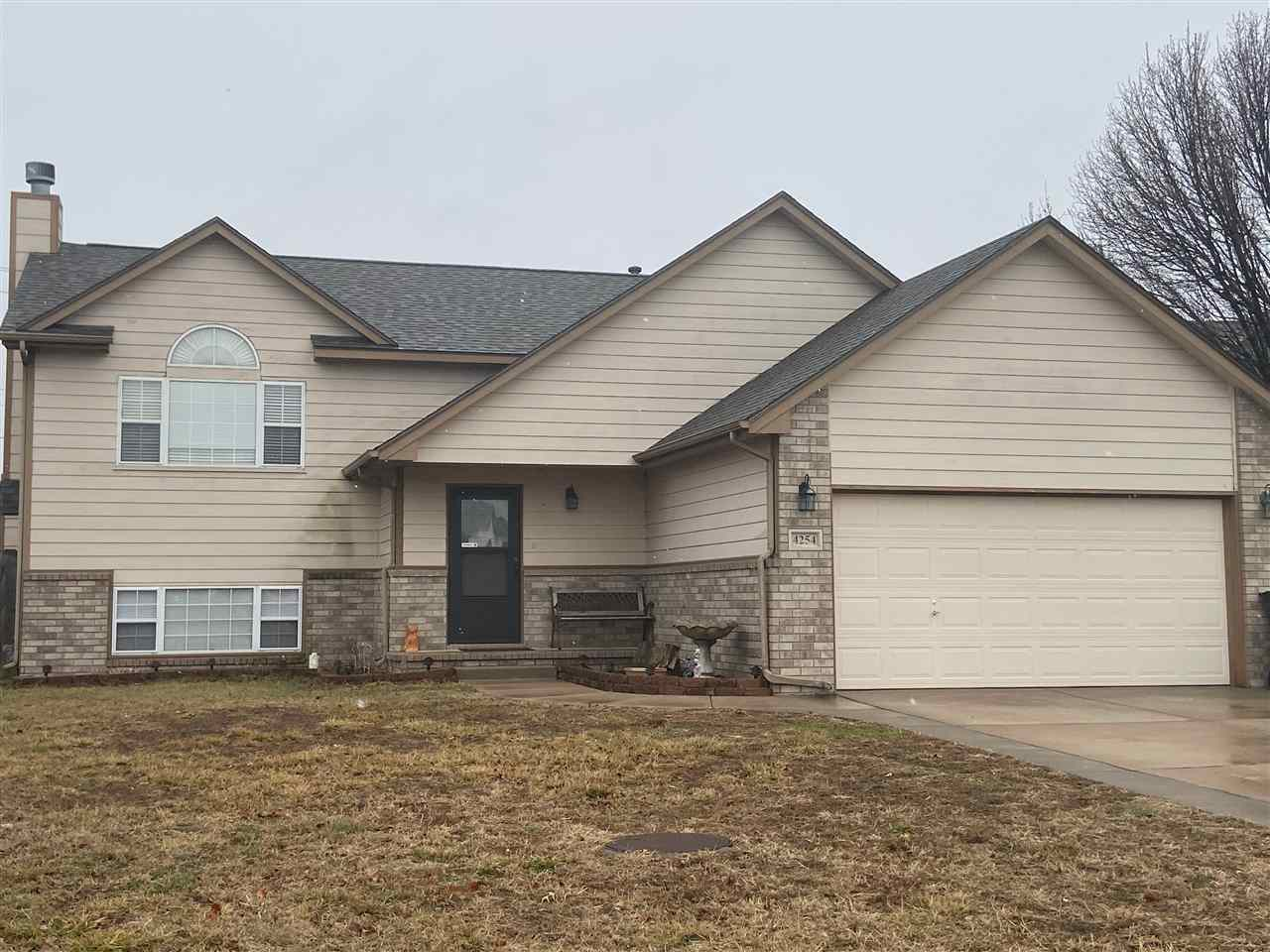 Large 5BR 3BA home in Haysville School District! Some updates include a new roof in 2018 and new AC
