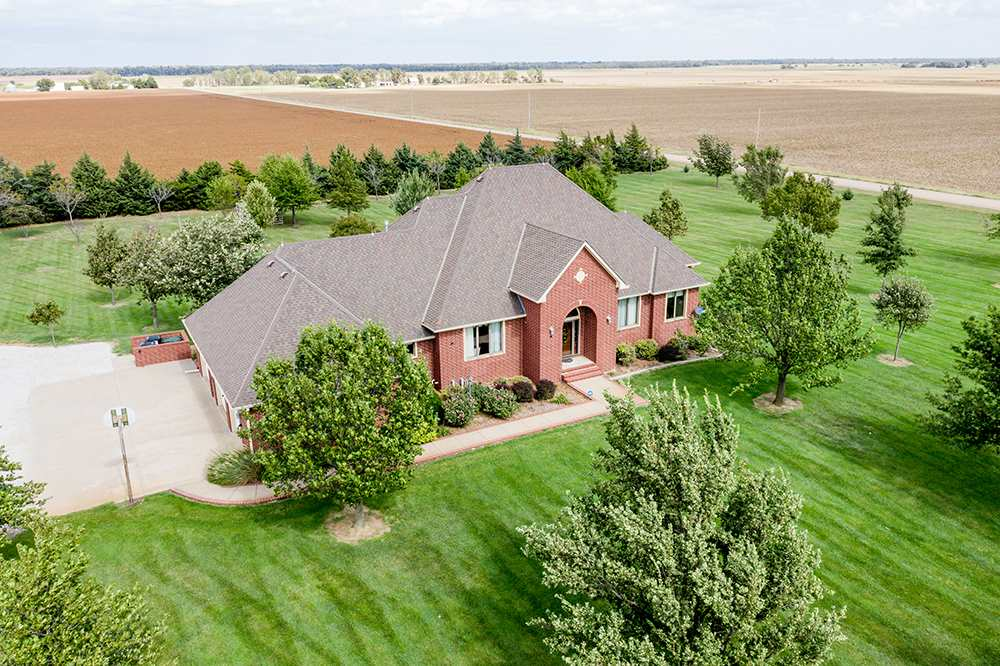 Country Living just minutes from the city!  This warm and inviting ranch is situated on 4.6 +/- acre