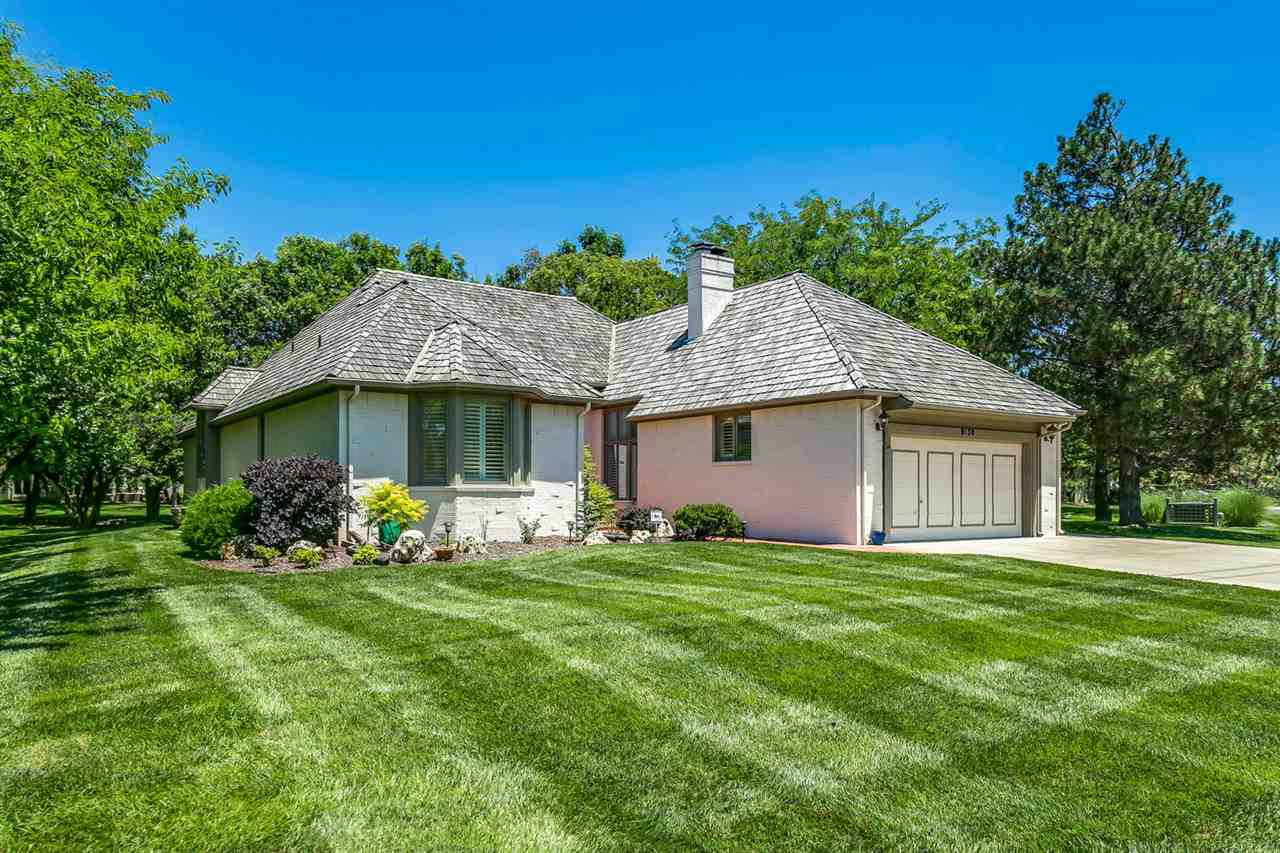You will love coming home to this newly remodeled patio home complete with hardwood flooring, fresh
