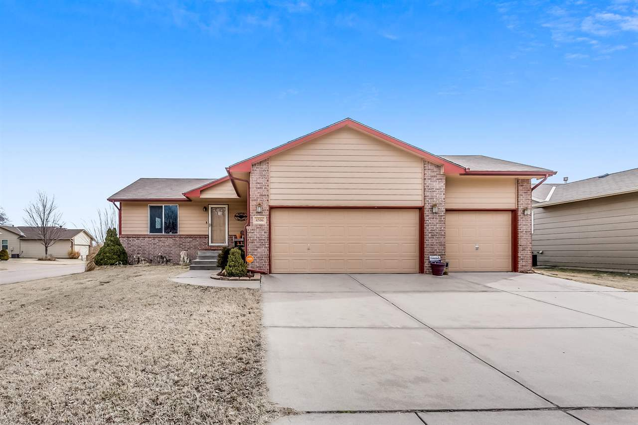 What a gem!  Don't miss your chance on this freshly updated home WITH A 3 CAR GARAGE!  This move-in