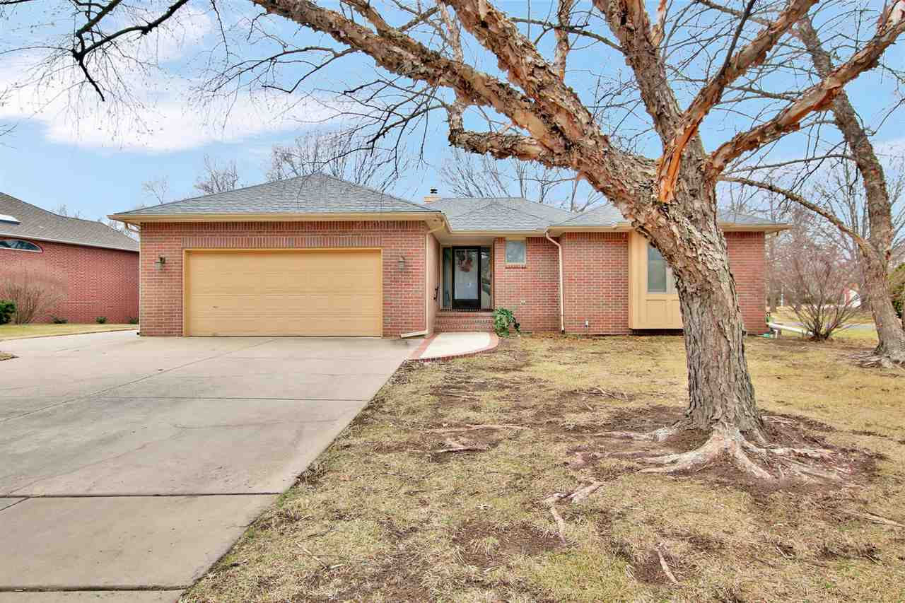 VALUE..VALUE...VALUE..Solid Oak wood flooring @ Large open living room & dining rooms! Solid Oak wood trim throughout this custom 4 bedroom, 3.5 bathroom home! Kitchen offers a cozy dining alcove w/ bench seating and lots of light, a large formal dining room, an island, pass through-bar, a pantry to die for, & cabinet space that is unreal! 2 bedrooms on the main, both with large walk-in closets & full baths;one has a walk in shower & the other a jetted tub! Basement offers a HUGE Family room w/ fireplace, 2 HUGE bedrooms with HUGE walk-in closets & a Jack and Jill bathroom! HUGE mechanical room @ approx. 43 x 15 & a large cedar walk-in closet....At almost 5,000 total sq. ft & solid oak trim & flooring, what would it cost to build today? I repeat, VALUE...Move In NOW...update with YOUR preferences/taste. After all you have time since YOU don't have to mow the lawn!! Golf? Drive your cart right over to the Crestview Country Club!